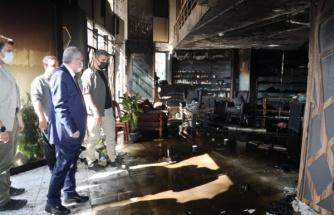 Başkan Beyazgül yanan mağazada incelemelerde bulundu
